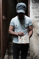 Mohammed 28 years Old had to stop studying at 14 years because he could not find any high school that could take palestinians in Beirut. Showing his Palestinian passport as a trap, Paestinians arent recognised and considered as second class citizen in Beirut.Beirut, Lebanon. August 2015