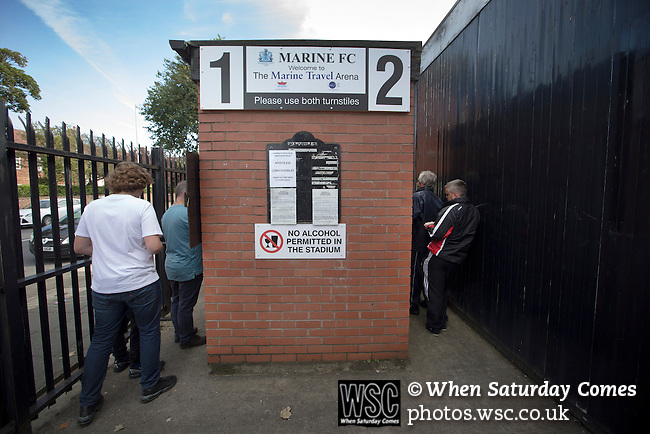 Marine 3 Ilkeston FC 1, 19/09/2015. The Mersey Travel Arena, Northern Premier League. Supporters paying for their admission at a turnstile at the Mersey Travel Arena, home to Marine Football Club, pictured before they played host to Ilkeston FC in a Northern Premier League premier division match. The match was won by the home side by 3 goals to 1 and was watched by a crowd of 398. Marine are baed in Crosby, Merseyside and have played at Rossett Park (now the Mersey Travel Arena)  since 1903, the club having been formed in 1894.  Photo by Colin McPherson.