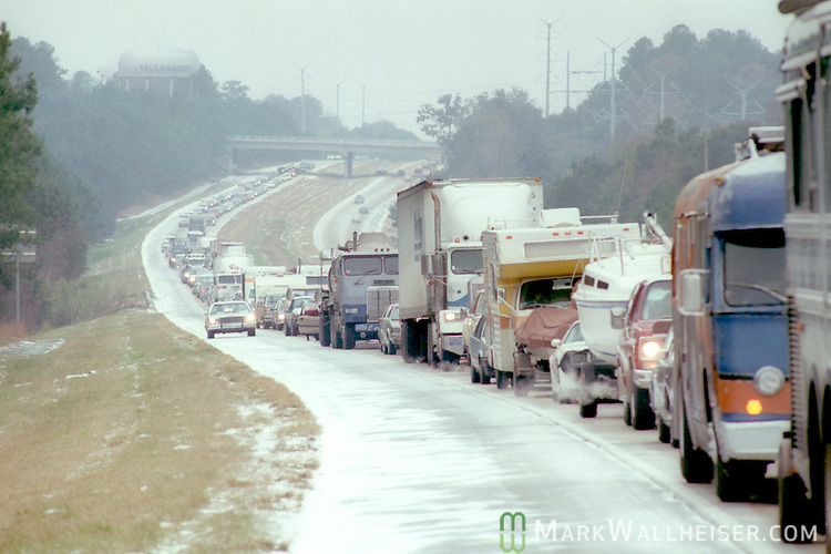 Traffic backs up on I-10 after a heavy snow and ice storm caused several accidents two days before Christmas 1989.  The December 23rd snow accumulated enough to cause traffic issues and build snow men.