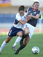 23 August 2004:   Julie Foudy battles for the ball against Pia Wunderlich of Germany during the semifinal game at Pankritio Stadium in Heraklio, Greece.     USA defeated Germany, 2-1 in overtime,  .   Credit: Michael Pimentel / ISI