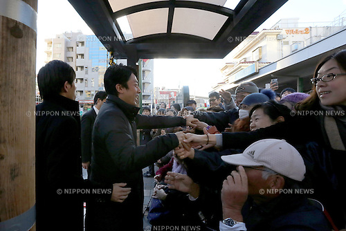 Japan's ruling Liberal Democratic Party (LDP) lawmaker Shinjiro Koizumi shakes hands with voters upon his arrival to deliver a speech to support a candidate in Kawasaki city, Japan, on Saturday, December 13, 2014.  (Photo by Yuriko Nakao/AFLO)