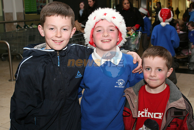 Caélum Connor, Anthony Burke and Óran Connor at the Christmas Carol Singing with Mell National School...Photo NEWSFILE/Jenny Matthews.(Photo credit should read Jenny Matthews/NEWSFILE)....This Picture has been sent you under the condtions enclosed by:.Newsfile Ltd..The Studio,.Millmount Abbey,.Drogheda,.Co Meath..Ireland..Tel: +353(0)41-9871240.Fax: +353(0)41-9871260.GSM: +353(0)86-2500958.email: pictures@newsfile.ie.www.newsfile.ie.FTP: 193.120.102.198.