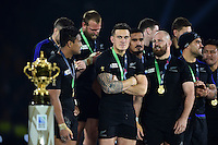 Sonny Bill Williams of New Zealand eyes the Webb Ellis Cup from the winners' podium. Rugby World Cup Final between New Zealand and Australia on October 31, 2015 at Twickenham Stadium in London, England. Photo by: Patrick Khachfe / Onside Images