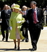 """Queen Elizabeth II is escorted by NASA Administrator Micheal Griffin, right, through the Rocket Garden outside the Visitor's Center at the NASA Goddard Space Flight Center, Wednesday, May 8, 2006, in Greenbelt, Md. At rear left is Prince Philip, the Duke of Edinburgh, and Goddard Space Flight Center Director Ed Weiler. The Royal couple's appearance was one of the last stops on a six-day visit to the United States. Photo Credit """"NASA/Paul E. Alers"""""""
