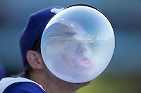 Winston-Salem Dash pitcher Yelmison Peralta (19) blows a bubble during the game against the Lynchburg Hillcats at BB&T Ballpark on July 28, 2016 in Winston-Salem, North Carolina.  The Dash defeated the Hillcats 9-3.  (Brian Westerholt/Four Seam Images)