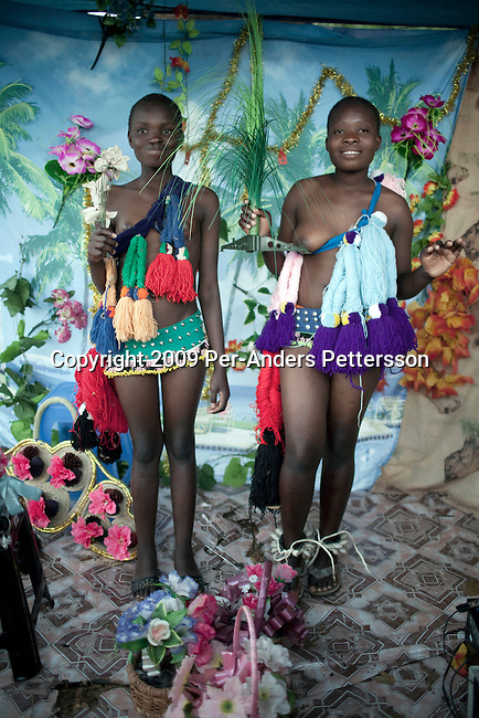 LUDZIDZINI, SWAZILAND - AUGUST 29: Girls pose for pictures in a photo studio before at a traditional Reed dance ceremony at the stadium at the Royal Palace on August 29, 2009, in Ludzidzini, Swaziland. About 80.000 virgins from all over the country attended this yearly event, which goes on for a week and the biggest in Swazi culture. It was founded to celebrate the beauty of Swazi women and girls. King Mswati III, and absolute monarch, was born in 1968 and he has 14 wives and many children. The king danced with his men in front of the 80.000 girls. Many of the girls hope to get noticed by the king and to be chosen as a future wife, a ticket from poverty and into a life of privilege and luxury. The country is one of the poorest in the world and it is struggling with a high prevalence of HIV-Aids and severe poverty. (Photo by: Per-Anders Pettersson)...