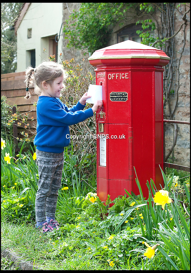 BNPS.co.uk (01202) 558833<br /> Picture: LauraJones/BNPS<br /> <br /> Red letter day for England's oldest post box as it once again becomes the pillar of the community...<br /> <br /> Sienna Caplen (4) posting a letter in England's oldest postbox in Holwell, Dorset.<br /> <br /> The oldest post box in England has had its red letter day after being spruced up with a new lick of paint and returned to its former glory.<br /> <br /> The iconic box was built in 1855 and is an unusual 'Butt' type design, which means it is an octagonal shape instead of cylindrical.<br /> <br /> It also has a vertical slot for letters to be dropped in instead of the horizontal ones we see today.<br /> <br /> The bright red box has stood on a roadside in Holwell near Sherborne, Dorset, for almost 160 years and was suffering from flaking paint and rust.