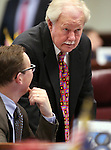 Nevada Sen. Ben Kieckhefer, R-Reno, seated, talks with former Sen. Mike Schneider on the Senate floor at the Legislative Building in Carson City, Nev., on Tuesday, April 7, 2015. <br /> Photo by Cathleen Allison