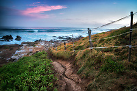 Path an fence to ocean at Hookipa beach area. Mauai, Hawaii.
