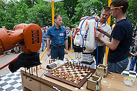 Moscow, Russia, 19/05/2012..A judge watches as Russia?s CHESSka robot is prepared for its match against the German-built KUKA Monster chess robot for the title of Absolute World Robot Chess Champion. The Russian robot, developed by chess coach Konstantin Kosteniuk, comprehensively defeated its opponent, created by KUKA Robotics, one of the world?s largest manufacturers of industrial robots.