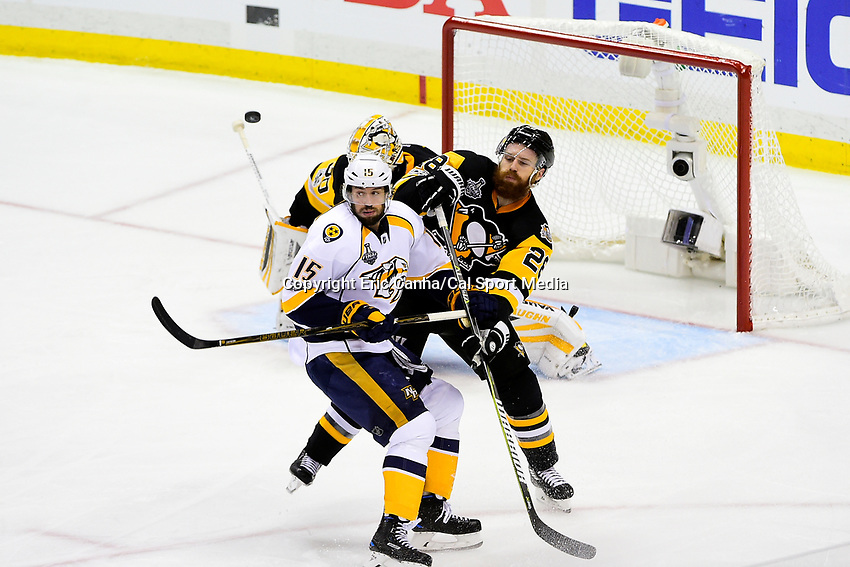June 8, 2017: Pittsburgh Penguins defenseman Ian Cole (28) battles with Nashville Predators center Craig Smith (15) in front of goalie Matt Murray (30) during game five of the National Hockey League Stanley Cup Finals between the Nashville Predators  and the Pittsburgh Penguins, held at PPG Paints Arena, in Pittsburgh, PA. Pittsburgh defeats Nashville 6-0 to lead the series 3-2. Eric Canha/CSM