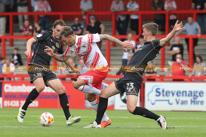 Jake Hyde of Stevenage tries to break through the MK Dons defence during Stevenage vs MK Dons, Friendly Match Football at the Lamex Stadium on 30th July 2016