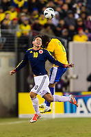 James Rodriguez (10) of Colombia goes up for a header with Daniel Alves (2) of Brazil. Brazil (BRA) and Colombia (COL) played to a 1-1 tie during international friendly at MetLife Stadium in East Rutherford, NJ, on November 14, 2012.