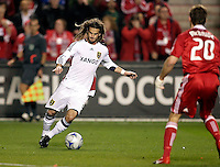 Real Salt Lake midfielder Kyle Beckerman (5) makes a move while Chicago Fire forward Brian McBride (20) looks on.  Real Salt Lake defeated the Chicago Fire in a penalty kick shootout 0-0 (5-4 PK) in the Eastern Conference Final at Toyota Park in Bridgeview, IL on November 14, 2009.