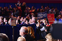 National Harbor, MD - February 23, 2018: Attendees of the Conservative Political Action Conference (CPAC) at the Gaylord National Hotel in National Harbor, MD, February 23, 2018, hold signs as President Donald Trump addresses the group.  (Photo by Don Baxter/Media Images International)