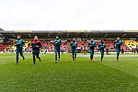(L-R) Angel Rangel fitness coach Eddie Lattimore, Oliver McBurnie, Leroy Fer, Luciano Narsingh, Nathan Dyer, and Mike van der Hoorn of Swansea City warm up prior to the Premier League match between Watford and Swansea City at the Vicarage Road, Watford, England, UK. Saturday 30 December 2017