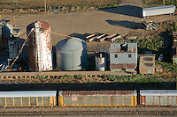 rail cars and silos in late summer sun