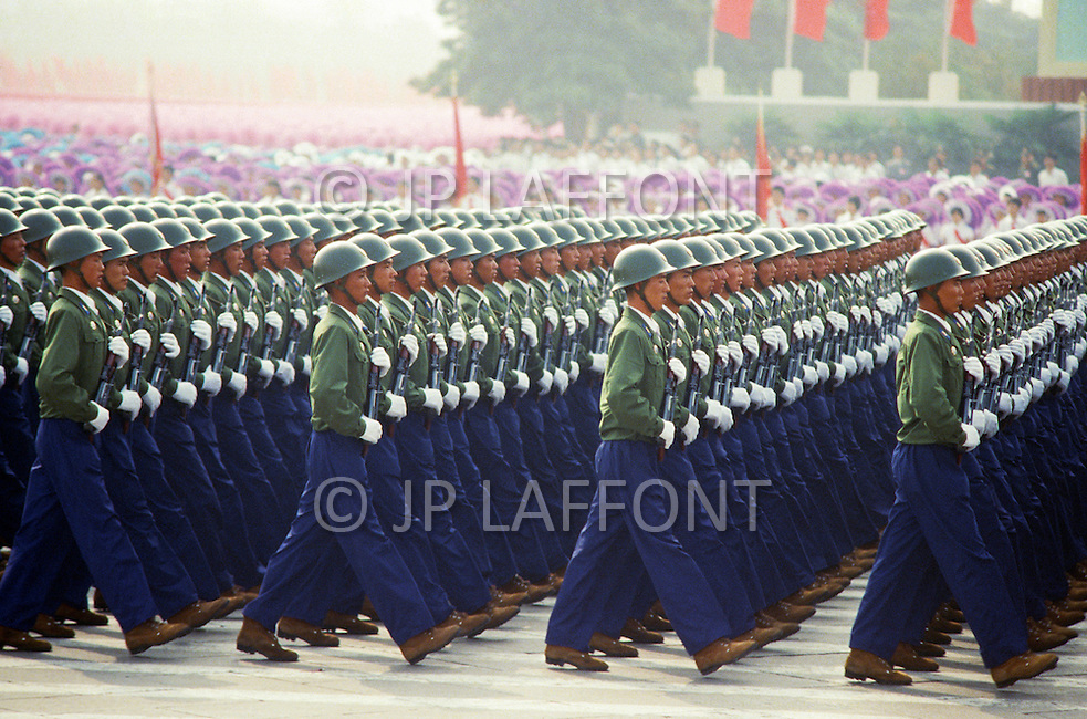 Beijing, China. October 1st, 1984. This huge parade is for the celebration of the 35th Anniversary of the Chinesse Revolution. Working force marching in millitary order.