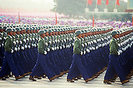 Beijing, China. October 1st, 1984. This huge parade is for the celebration of the 35th Anniversary of the Chinese Revolution. Working force marching in millitary order.
