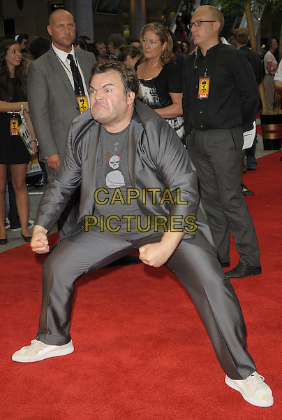 Jack Black .'Kung Fu Panda 2' UK film premiere at Vue Westfield, Shepherds Bush,.London, England, June 5th 2011..full length grey gray suit funny white trainers t-shirt pose gesture hands fists  .CAP/CAN.©Can Nguyen/Capital Pictures.