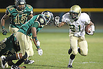 Harbor City, CA 09/24/10 - Deon Morris (Mira Costa # 21) and Marquise Lomax (Narbonne #2) in action during the Mira Costa-Narbonne varsity football game at Narbonne High School in Harbor City.