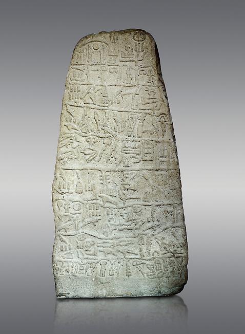 Neo Hittite Period Hieroglyphic inscription on a stone orthostat - Anatolian Civilisations Museum, Ankara, Turkey. Against a gray background.
