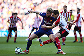 18th March 2018, Camp Nou, Barcelona, Spain; La Liga football, Barcelona versus Athletic Bilbao; Ivan Rakitic of FC Barcelona holds off Inigo Martinez of Athletic Bilbao
