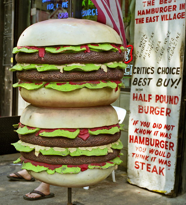 A giant burger outside a cafe in the East Village,Manhattan,NYC. 2005.