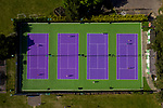 Pictured: Tennis players can be seen in action on the vivid purple tennis courts at Warsash Tennis Club in Warsash, Hants. Since the government eased lockdown restrictions and allowed certain recreational activities to recommence, players have been able to get back on the courts and have been 'served' their dose of tennis.Business has been rife for Warsash Tennis Club after starting up again due to the coronavirus pandemic, with droves of players descending onto the courts in recent days. <br /> <br /> © Jordan Pettitt/Solent News & Photo Agency<br /> UK +44 (0) 2380 458800