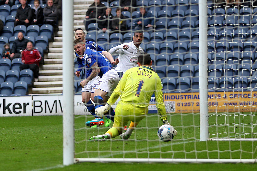 Preston North End's Jermaine Beckford scores his sides first goal   beating Rochdale's Josh Lillis<br /> <br /> Photographer Mick Walker/CameraSport<br /> <br /> Football - The Football League Sky Bet League One - Preston North End v Rochdale -  Friday 3rd April 2015 - Deepdale - Preston<br /> <br /> &copy; CameraSport - 43 Linden Ave. Countesthorpe. Leicester. England. LE8 5PG - Tel: +44 (0) 116 277 4147 - admin@camerasport.com - www.camerasport.com