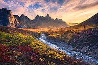 Beautiful sunset light and colorful tundra looking toward Tombstone Mountain during Autumn in the Ogilvie Mountain wilderness, Yukon Territory.