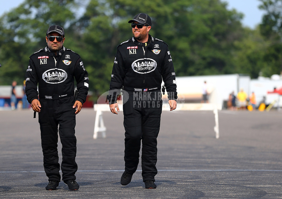 Aug. 18, 2013; Brainerd, MN, USA: NHRA top fuel dragster drivers Khalid Albalooshi (left) and teammate Shawn Langdon during the Lucas Oil Nationals at Brainerd International Raceway. Mandatory Credit: Mark J. Rebilas-