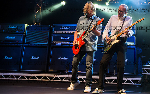 Status Quo-Rick Parfitt (L) & Francis Rossi (R) performing live Hammersmith Apollo London - 28 March 2014.  Photo credit: Iain Reid/IconicPix