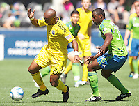 Columbus Crew forward Emilio Renteria, left, gets around Seattle Sounders FC defender Jhon Kennedy Hurtado during play at CenturyLink Field in Seattle Saturday Aug. 27, 2011. The Sounders FC won the game 6-2.