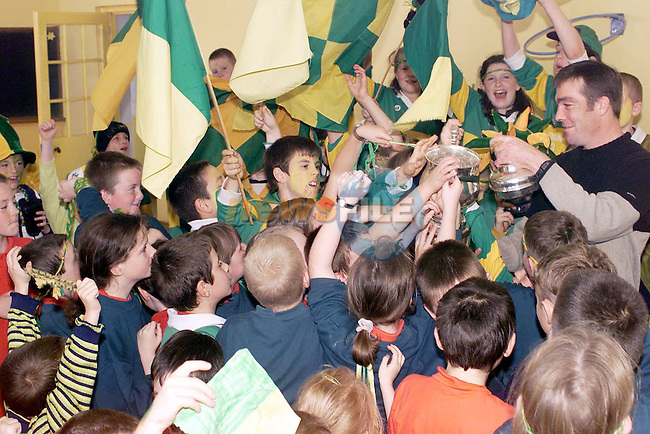 Surrounded......John Osborne, Naomh Fionnbarra is surrounded by pupils from St. Finian's NS Dillonstown..Picture: Newsfile