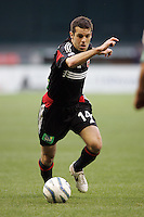7 May 2005.  DC United's Ben Olsen (14) sprints forward with the ball at RFK Stadium in Washington, DC.