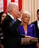 United States Vice President Joe Biden (L) takes the oath of office from Supreme Court Justice Sonia Sotomayor as his wife Jill Biden holds the family bible while family members look on at the Vice President's residence at the Naval Observatory  in Washington January 20, 2013.  .Credit: Kevin Lamarque / Pool via CNP