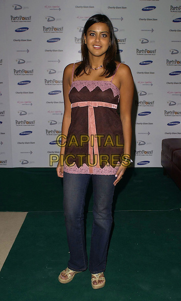 POOJA SHAH.At Charity Glam Slam Poker Tournament, .Titanic, Brewer Street, London, England, .April 22nd 2006..full length jeans wedges pink purple lace top bow ribbon.Ref: CAN.www.capitalpictures.com.sales@capitalpictures.com.©Can Nguyen/Capital Pictures