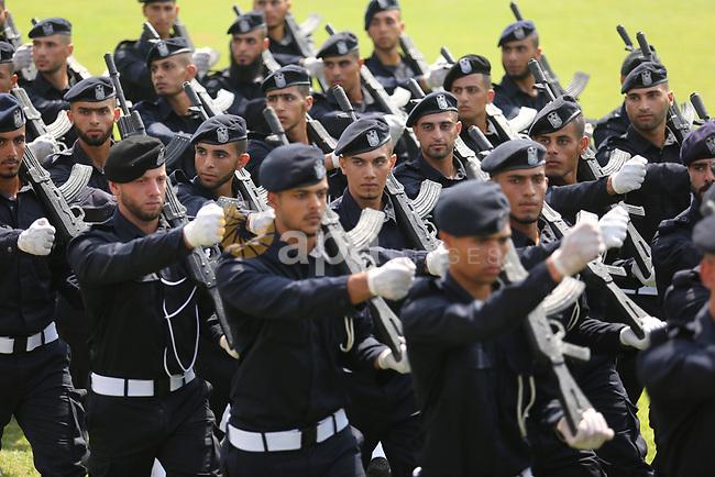 Palestinian policemen take part in a graduation ceremony, in Gaza City on July 17, 2017. Photo by Ashraf Amra
