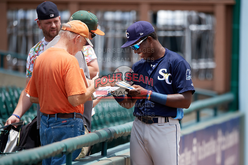 Charlotte Stone Crabs right fielder Jesus Sanchez (4) signs autographs before a game against the Bradenton Marauders on June 3, 2018 at LECOM Park in Bradenton, Florida.  Charlotte defeated Bradenton 10-1.  (Mike Janes/Four Seam Images)