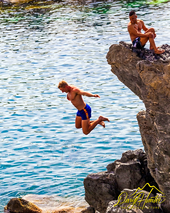 Cliff jumper at the habor in Manarola, Cinque Terre, Italy
