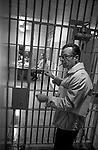 November 21, 1968, Modesto, California--Radio Man--Dick Boynton at County Jail.  Wellesley Richard &quot;Dick&quot; Boynton was the news editor at KBEE AM, The Modesto Bee's sister radio station.  In November 1968, Dick volunteered to be my subject for a day-in-the-life-of-a-radio-reporter story.  My goal was to improve my story-telling skills.  I asked Dick to just do his job and ignore me.  We met at 6 a.m. at the Stanislaus County jail to get booking information then were off to Modesto Police Department to read the police logs.  At MPD, we discovered a big story was unfolding.  Stanislaus County Superintendent of Schools Fred Beyer and his deputy Joseph Howard had died the night before in a plane crash coming back from Fresno.  Making images was easy under these circumstances: I just followed Dick as he worked.  I moved in and out while Dick ignored me, just as I had asked.  When he finally sat down to write copy, he talked aloud and banged away on his typewriter.  Next thing I knew, he was on the air broadcasting the news.<br /> Boynton worked as the news editor for KBEE for nearly a decade under managers Roy Swanson and Ed Boyle.  Earlier in his career, his deep, resonant voice was heard on the airwaves at KWG in Stockton.  Boynton had also worked as a newsman for radio stations in Salinas and San Diego.  Among racing fans, Dick was known as a winning driver of dragsters and super-stock cars.<br /> In September 1986, Dick Boynton ended his own life. Some said he was despondent over being laid off from KBEE.  Photo by AL Golub/Golub Photography