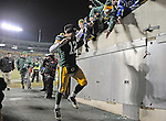 Green Bay Packers quarterback hops to greet the fans as he enters the tunnel after a 45-17 win over the New York Giants at Lambeau Field in Green Bay, Wis., on Dec. 26, 2010.