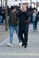 Thursday 20 February 2014<br /> Pictured: Napoli Supporters walk through Swansea City Centre, many covering their faces. <br /> Re: Napoli Supporters visit Swansea for tonights UEFA Leauge clash