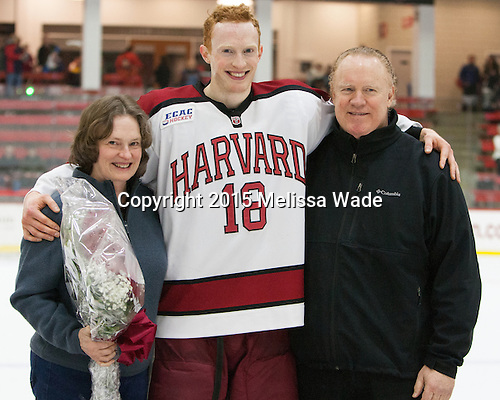 Mike Seward (Harvard - 18) and his parents - The Harvard University Crimson defeated the visiting Princeton University Tigers 5-0 on Harvard's senior night on Saturday, February 28, 2015, at Bright-Landry Hockey Center in Boston, Massachusetts.