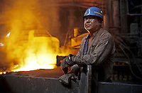 A steel worker in Benxi Iron and Steel Group in Liaoning. China's second-largest steelmaker Anshan Iron & Steel Group has merged with smaller rival Benxi Steel Group to create a company with capacity that will match the mainland's biggest steelmaker, Shanghai Baosteel Group..01 Sep 2005