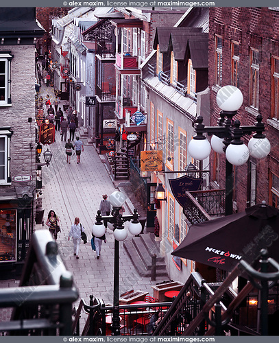 People walking in historic streets Rue du Petit Champlain and Rue Sous Le Fort of old Quebec City in the evening, view from above. Quebec, Canada. Rue du Petit-Champlain, Ville de Québec.