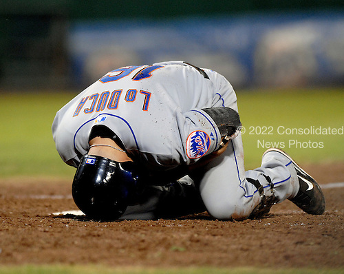 Washington, D.C. - September 19, 2007 -- New York Mets catcher Paul LoDuca (16) holds his wrist after striking out in the eighth inning against the Washington Nationals at RFK Stadium in Washington, D.C. on Wednesday, September 19, 2007.  The Mets wonthe game 8 - 4..Credit: Ron Sachs / CNP.(RESTRICTION: NO New York or New Jersey Newspapers or newspapers within a 75 mile radius of New York City)