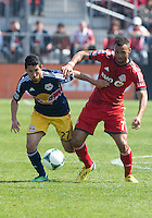 27 April 2013: Toronto FC midfielder John Bostock #7 and New York Red Bulls defender Kosuke Kimura #27 in action during the second half in an MLS game between the New York Red Bulls and Toronto FC at BMO Field in Toronto, Ontario Canada..The New York Red Bulls won 2-1....