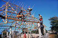 Carpenters using Casuarina tree for house roof frames